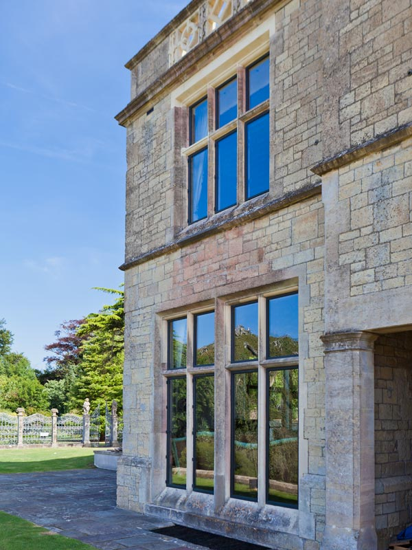 commercial country estate renovation bronze windows