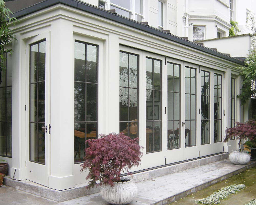orangery with bronze folding doors