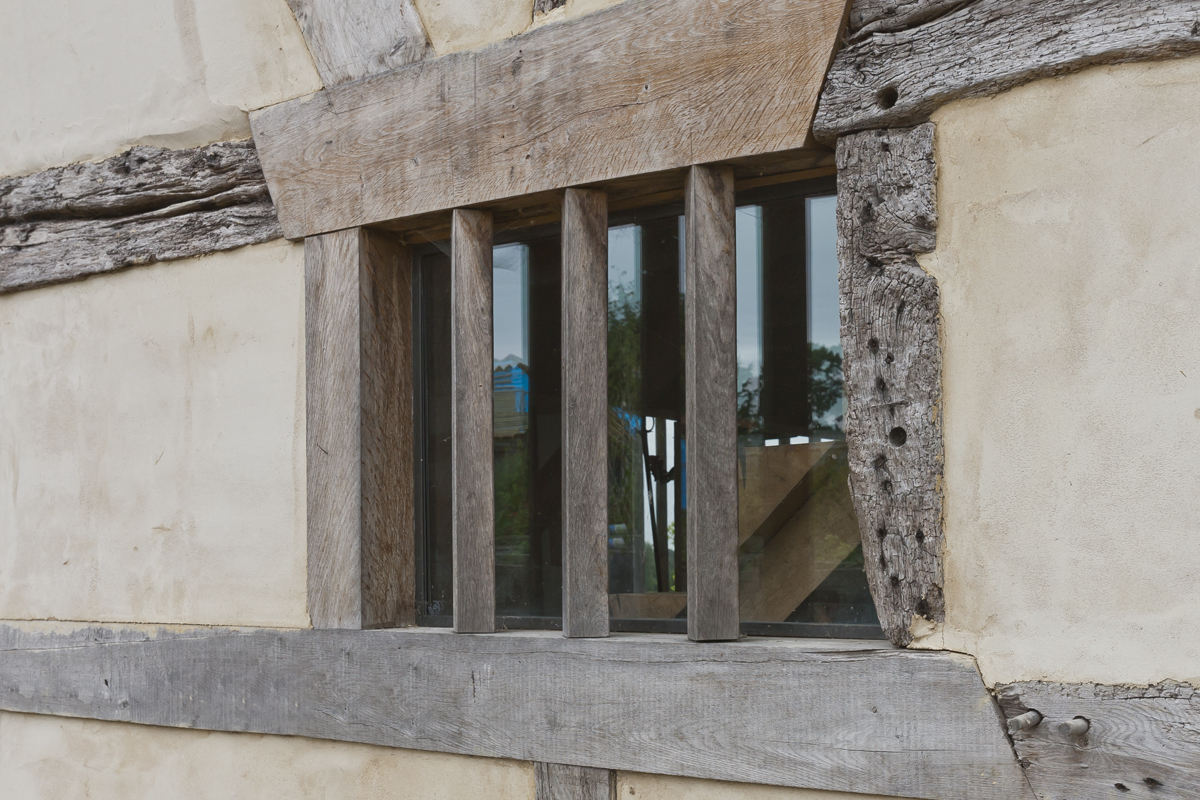 bronze windows in a renovated country house with kiln distorted glass