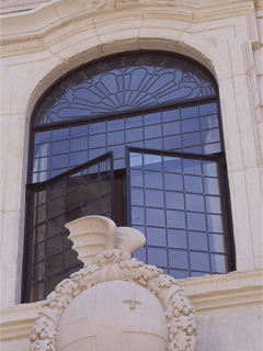 curved screen of bronze windows