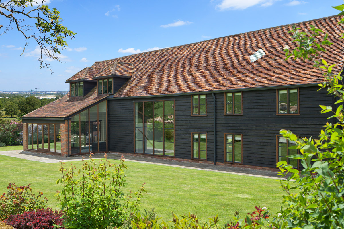 barn renovation with striking bronze windows