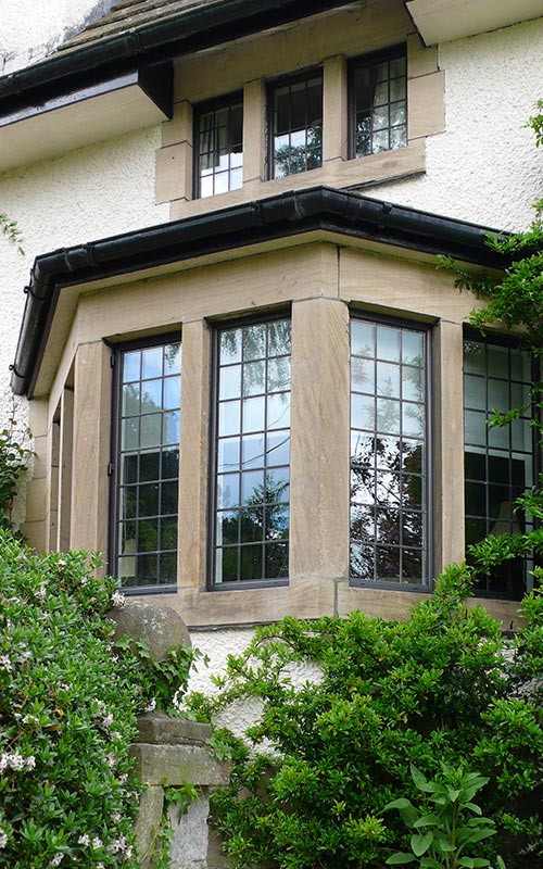 Home with bronze windows with lead detailing