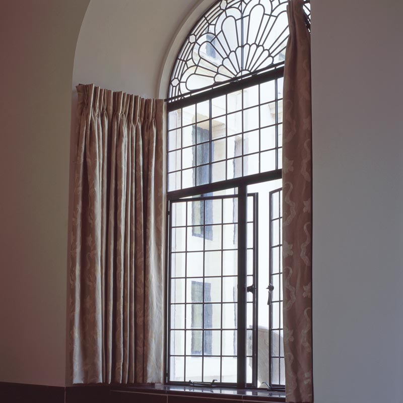 interior view of bronze windows in a listed property