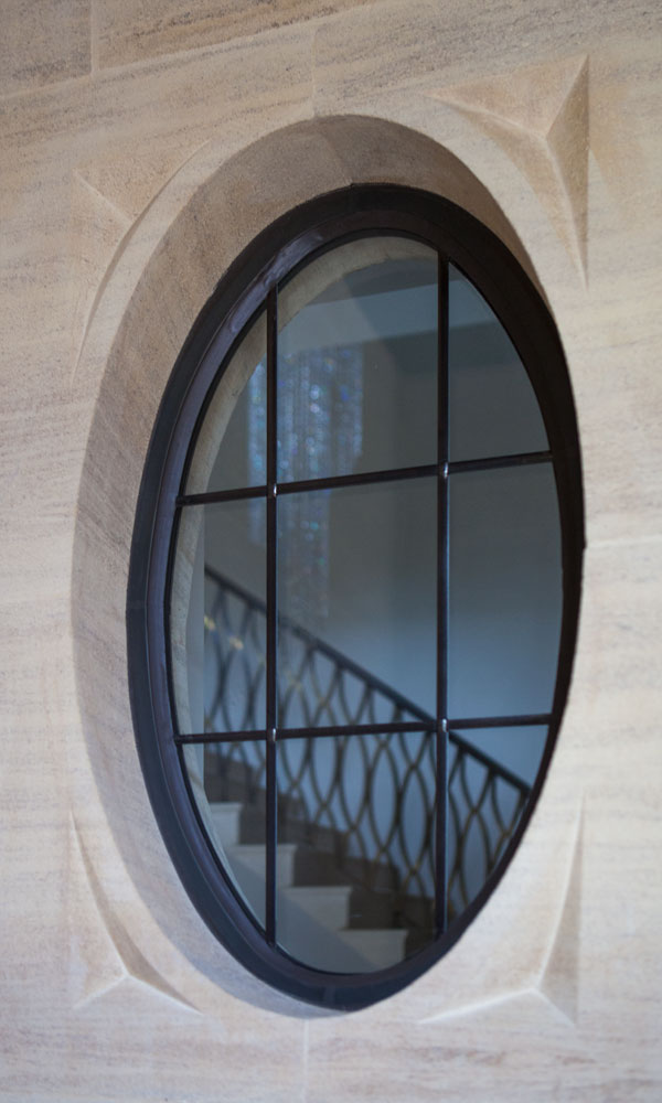 Bespoke bronze window with oval design